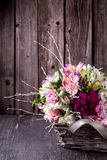 Bouquet from gillyflowers and alstroemeria in the basket on old Royalty Free Stock Photography