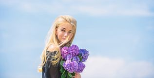 Bouquet for girlfriend. Girl tender fashion model hold hydrangea flowers bouquet. Fashion and beauty industry. Meet stock photos
