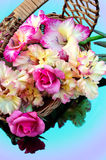 Bouquet of gladioli and roses. Are in a wicker basket Royalty Free Stock Image