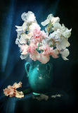 Bouquet of gladioluses in a beautiful jug. Still-life with a bouquet of gladioluses and a ceramic jug royalty free stock photos