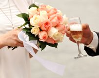 Bouquet and Glass of champagne Stock Images