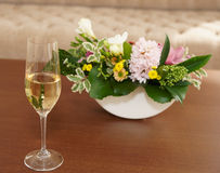 Bouquet and glass of champagne Royalty Free Stock Photo