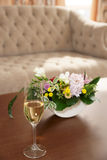 Bouquet and glass of champagne Royalty Free Stock Images