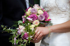 Bouquet and gold ring on hand Royalty Free Stock Image