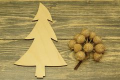 Christmas tree made of wood and decorative apples on a dark wooden background stock image