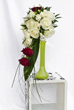 Bouquet in green vase. Bridal bouquet in green vase on white cube stock images