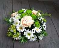 Bouquet from green and white chrysanthemums in a basket Royalty Free Stock Image