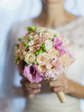 Bouquet in hand of bride Royalty Free Stock Image