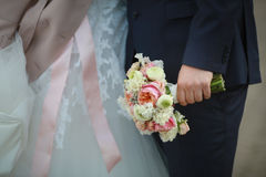 The bouquet in hand Stock Photography