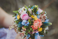 The bouquet in hand Royalty Free Stock Photo
