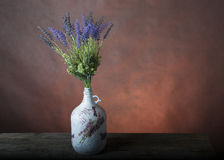 Bouquet in the hand painted vase Royalty Free Stock Photos