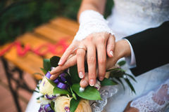Bouquet hand wedding ring. Finger couple married Stock Image