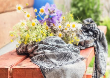 Bouquet and handkerchief on bench Royalty Free Stock Photos