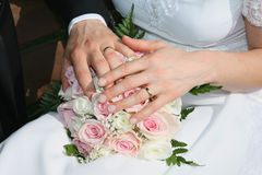 Bouquet and hands Stock Images