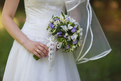 Bouquet in the hands of the bride Stock Photos