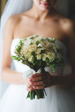 Bouquet in hands Stock Images