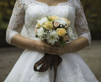 Bouquet in hands of the bride Royalty Free Stock Photography