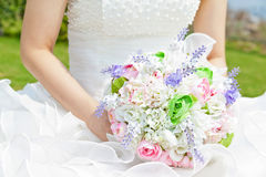 Bouquet in the hands of the bride Royalty Free Stock Images