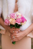 Bouquet in the hands Stock Photography