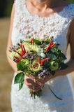 Bouquet in hands of bride Royalty Free Stock Photo