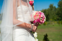 Bouquet in hands of bride Royalty Free Stock Photos