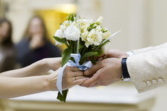 Bouquet in the hands of the bride and groom Royalty Free Stock Photo