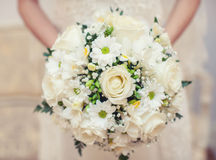 Bouquet in hands Stock Photography