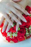 Bouquet. Hands of the bride on a wedding bouquet Royalty Free Stock Photo