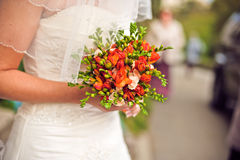 bouquet in the hands of the bride royalty free stock image