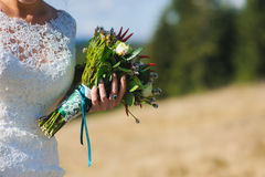 Bouquet in hands of bride. Wedding mountains. Royalty Free Stock Photography