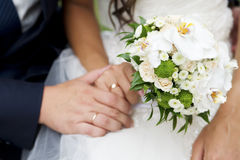 Bouquet and hands with rings Stock Images