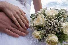 Bouquet and hands with rings Stock Photos