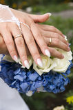 Bouquet and hands with rings Stock Image