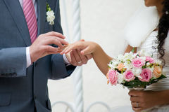 Bouquet and hands with rings Royalty Free Stock Photos