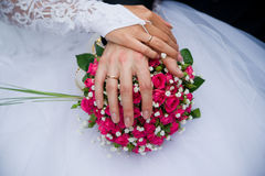 Bouquet and hands with rings Royalty Free Stock Images