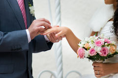 Bouquet and hands with rings Royalty Free Stock Photography