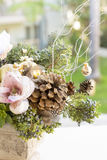 Bouquet has Christmas tree branches and artificial flowers. Royalty Free Stock Image