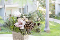 Bouquet has Christmas tree branches and artificial flowers. Stock Photo
