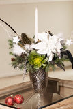 Bouquet has Christmas tree branches and artificial flowers. Stock Photography
