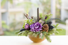 Bouquet has Christmas tree branches and artificial flowers. Royalty Free Stock Images