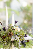 Bouquet has Christmas tree branches and artificial flowers. Royalty Free Stock Photos