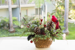 Bouquet has Christmas tree branches and artificial flowers. Stock Image