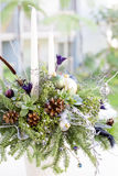 Bouquet has Christmas tree branches and artificial flowers. Stock Images