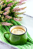 Bouquet of heather, tea mug and knitted scarf. Selective focus royalty free stock photo