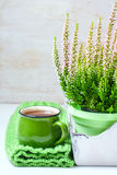 Bouquet of heather, tea mug and knitted scarf Royalty Free Stock Photography