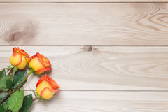 Bouquet for the holiday of three roses on a wooden boards Royalty Free Stock Image
