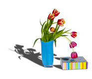 Bouquet by a holiday1. The image of a bouquet of tulips and a gift box Stock Photos