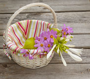 A bouquet of  hosta and cosmos in a basket Stock Images