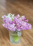 Bouquet of hyacinths flowers in a crystal vase.Spring flowers Stock Photo