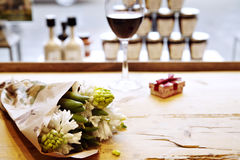 Bouquet of hyacinths on wooden table in cafe in front of window. St. Valentine`s day Royalty Free Stock Photo